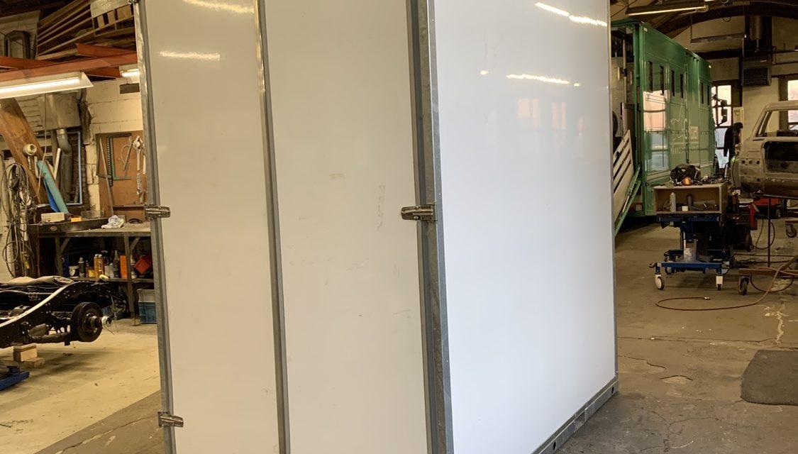Verhuiscontainer aan het ontwikkelen.